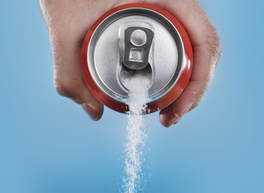 Diet soda can pouring out sugar